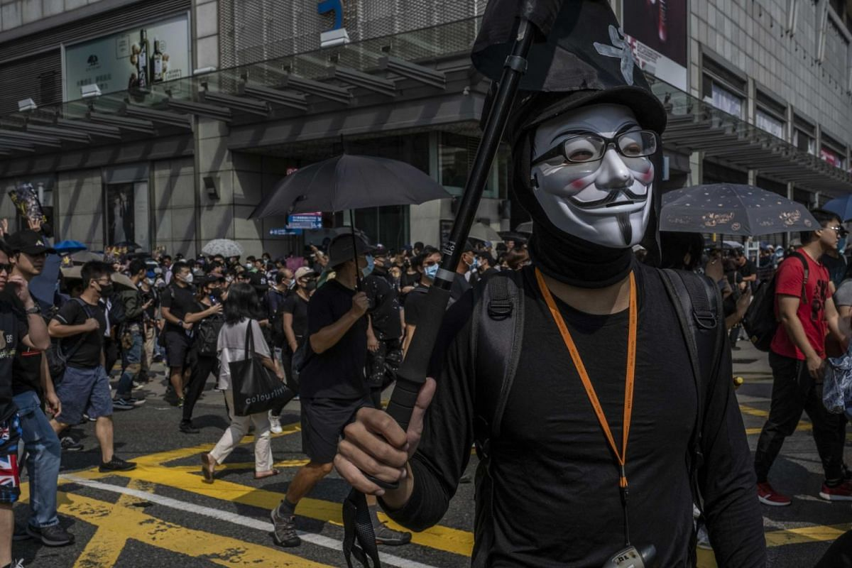 A masked protester in the Tsim Sha Tsui district of Hong Kong, on Oct 20, 2019. The Sunday demonstration, which followed 20 weeks of anti-government protests, is a test of the movement's strength amid increasing violence.