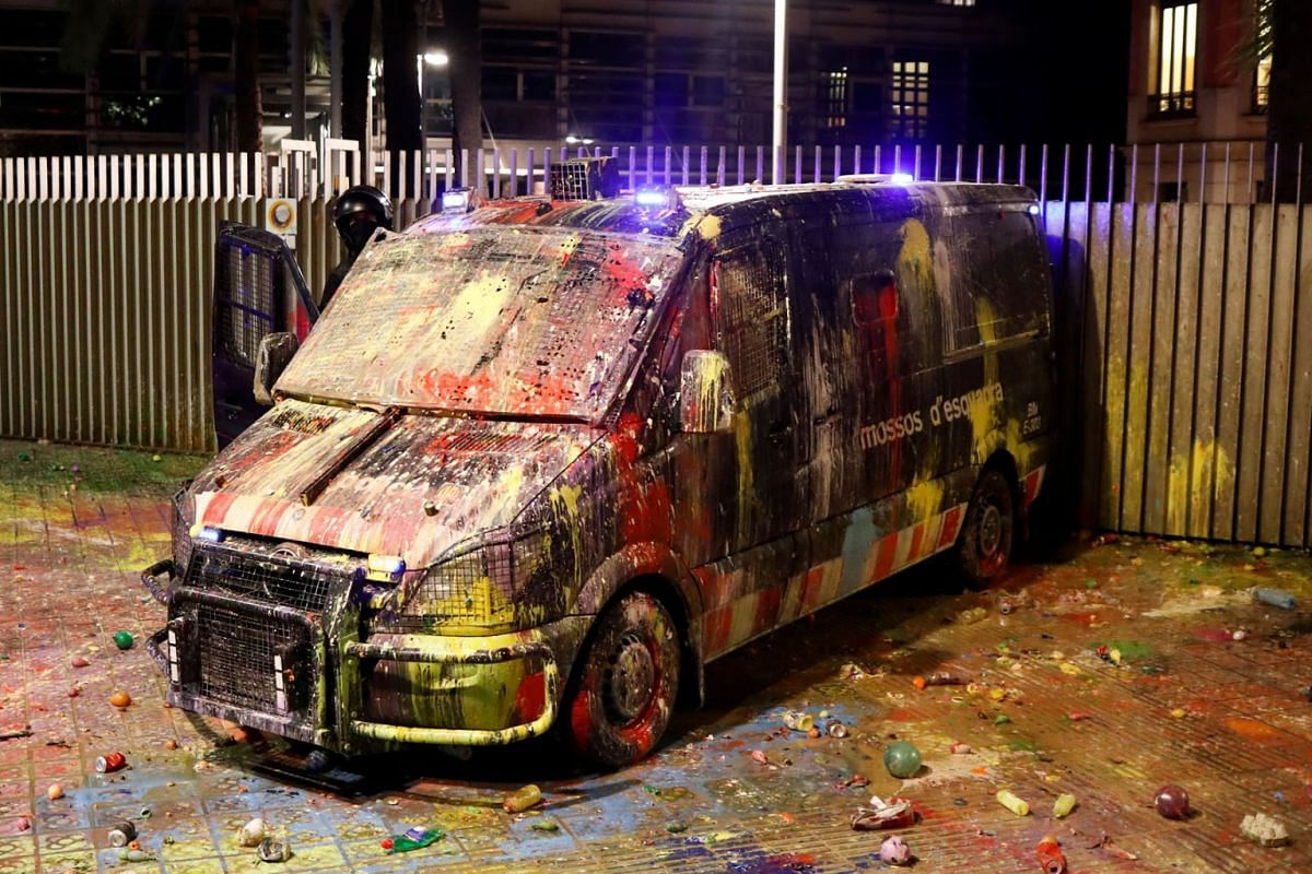 A police officer checks a van that was covered with paint during a protest outside the Spanish government delegation offices in Barcelona, Spain October 21, 2019. PHOTO: REUTERS