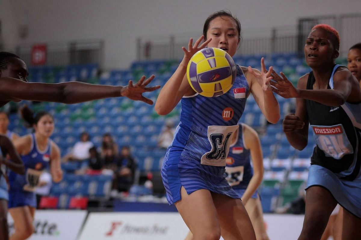 Singapore's Toh Kai Wei in action as Singapore take on Botswana in the M1 Nations Cup netball tournament at the OCBC Arena on Oct 21, 2019. The tournament is the team's final tune-up for the SEA Games. PHOTO: THE STRAITS TIMES/JASON QUAH