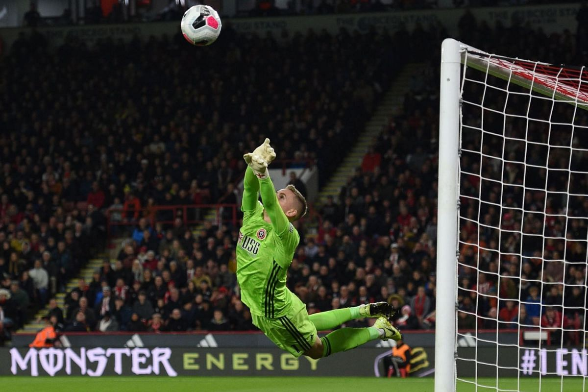 Sheffield United's English goalkeeper Dean Henderson makes a save during the English Premier League football match between Sheffield United and Arsenal at Bramall Lane in Sheffield, northern England on October 21, 2019. PHOTO: AFP