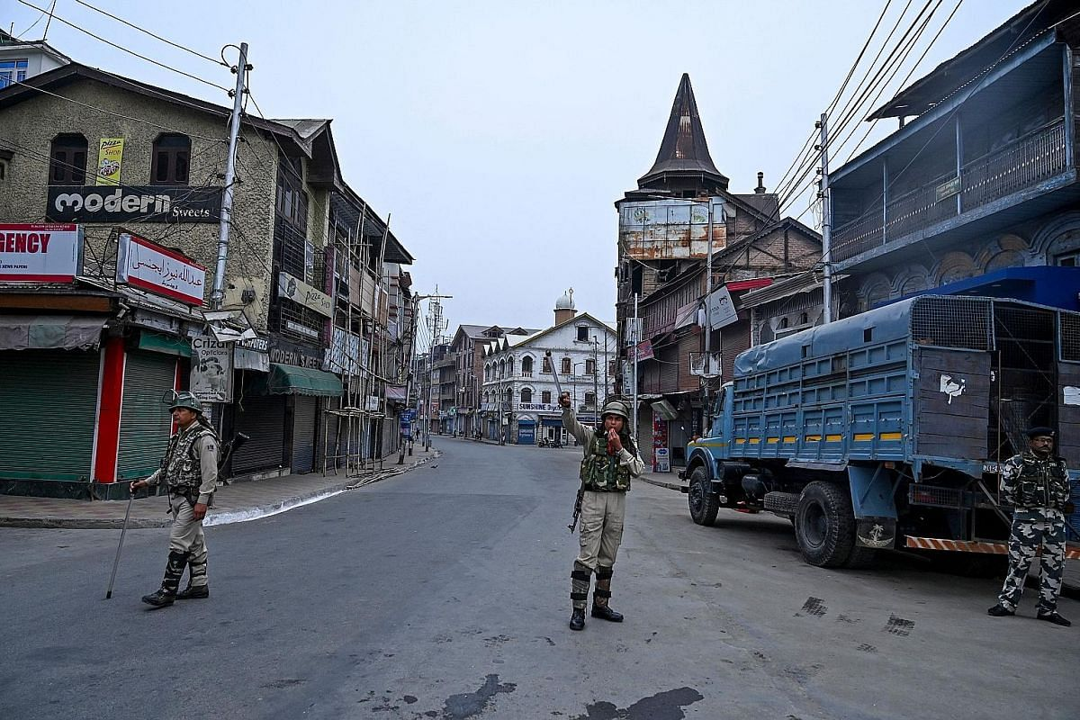 Soldiers standing guard on the streets of Srinagar. New Delhi sent in more than 25,000 troops when it revoked the special status of Jammu and Kashmir in August. Kashmiris busy on their cellphones after the Indian authorities lifted a ban on postpaid