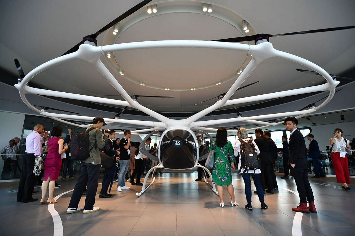 Visitors checking out the Volocopter 2X in the VoloPort on Oct 22, 2019. PHOTO: THE STRAITS TIMES/LIM YAOHUI