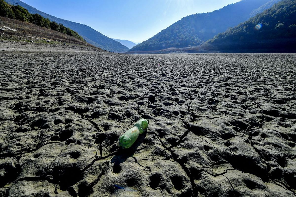 A plastic bottle lies on a dry surface of the Kozjak Lake that is at its minimum level due to increased power production and a long period of autumn drought, some 60km southwest from Skopje, North Macedonia, October 22, 2019. PHOTO: EPA-EFE
