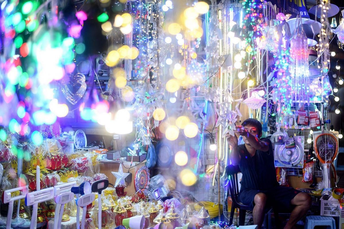A Vietnamese vendor selling decorative lights waits for customers in Hanoi on October 22, 2019. PHOTO: AFP