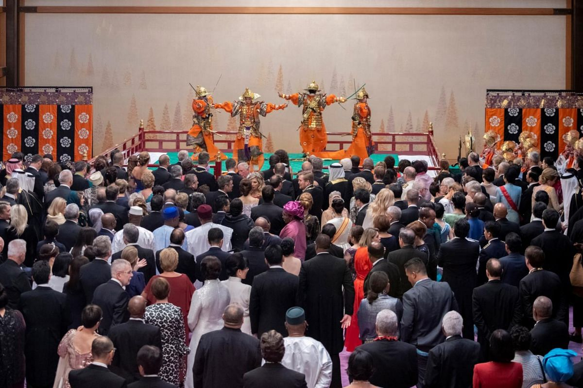 Guests mingle in the Grand Hall during the court banquet at the Imperial Palace in Tokyo, Japan, on Oct 22, 2019.