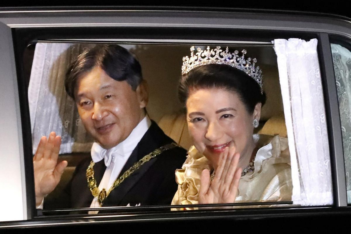 Japanese Emperor Naruhito and Empress Masako on their way to the Imperial Palace for the court banquet in Tokyo, Japan, on Oct 22, 2019.