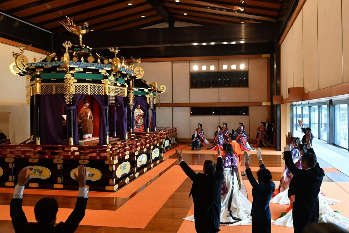 """Japan's Emperor Naruhito and Empress Masako receive """"banzai"""" cheers during the enthronement ceremony at the Imperial Palace in Tokyo, Japan, on Oct 22, 2019."""