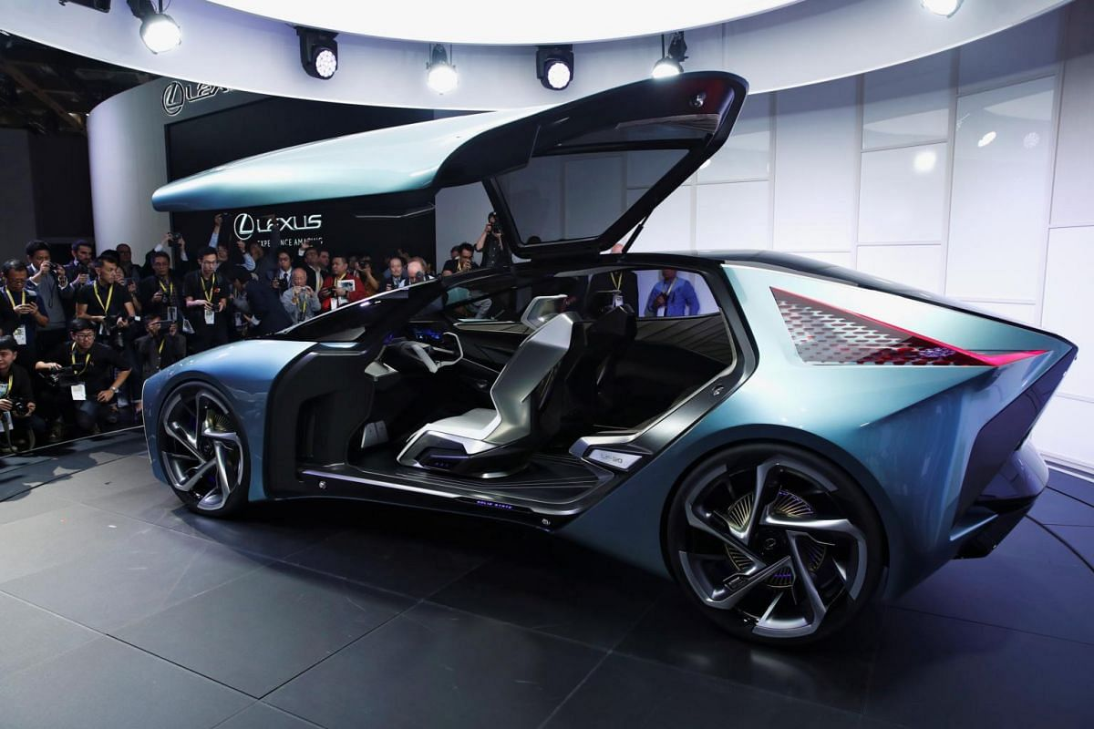 People look and take photos of Lexus' new LF-30 electric vehicle concept car as it is unveiled at the Tokyo Motor Show, in Tokyo, on Oct 23, 2019.