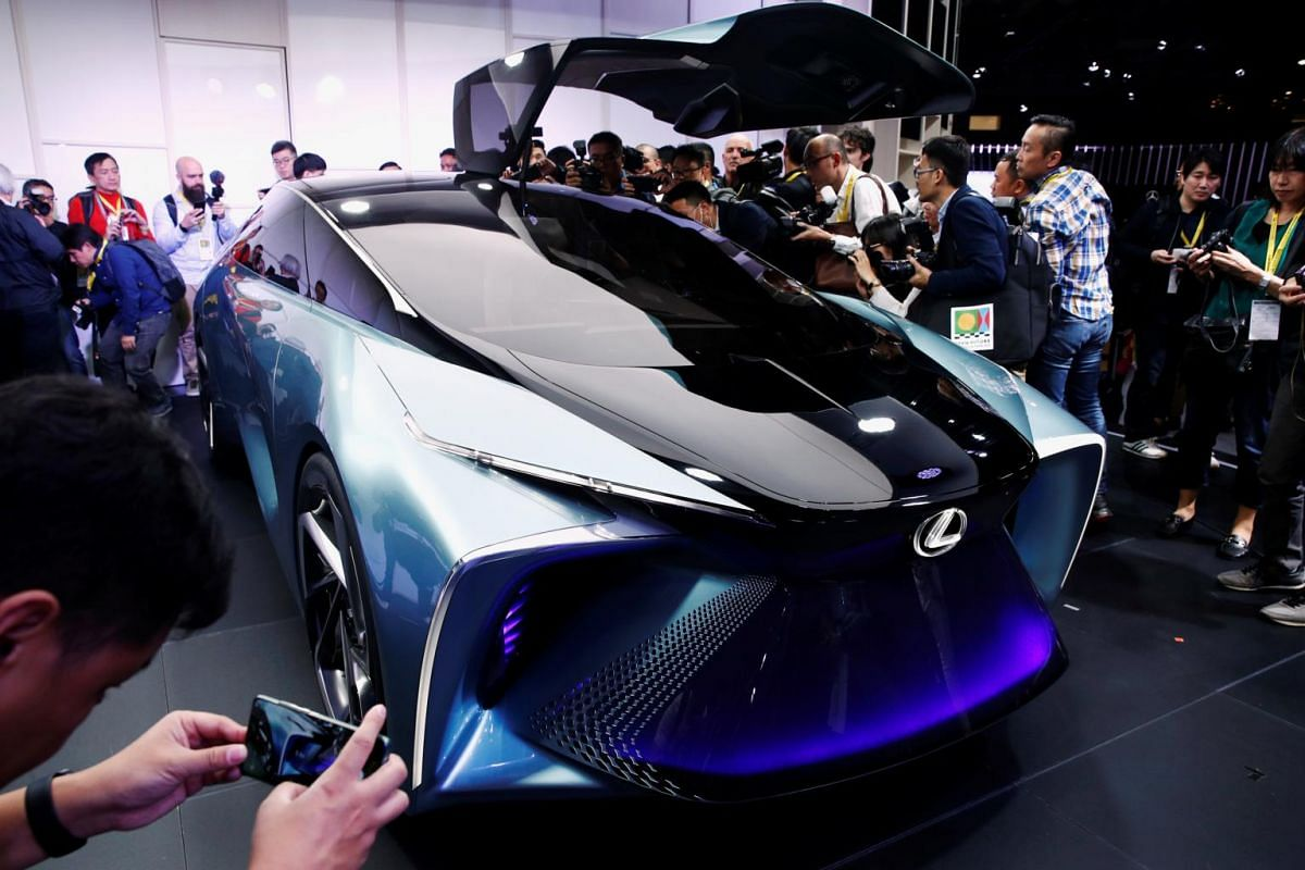 People look and take photos of Lexus' new LF-30 electric vehicle concept car as it is unveiled at the Tokyo Motor Show, in Tokyo on Oct 23, 2019.