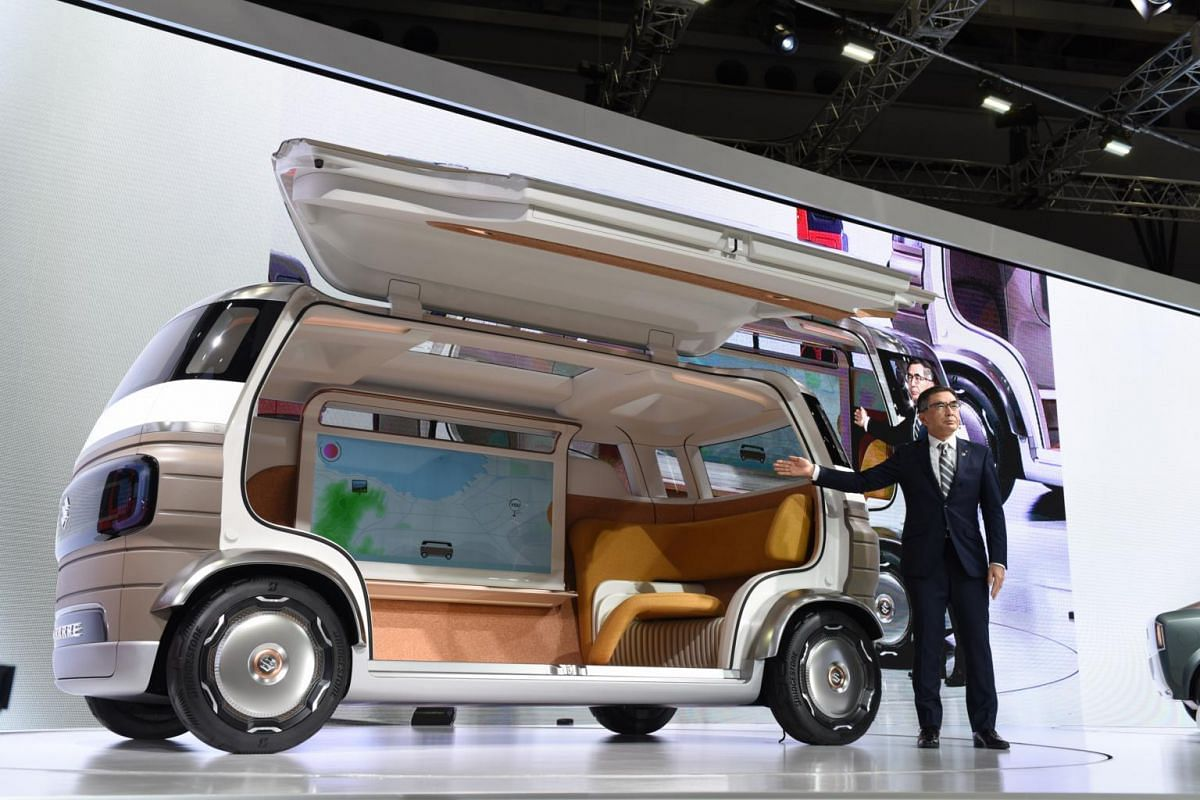 Mr Toshihiro Suzuki, president of Suzuki Motor Corp, presents the Hanare concept vehicle at the Tokyo Motor Show, in Tokyo on Oct 23, 2019.