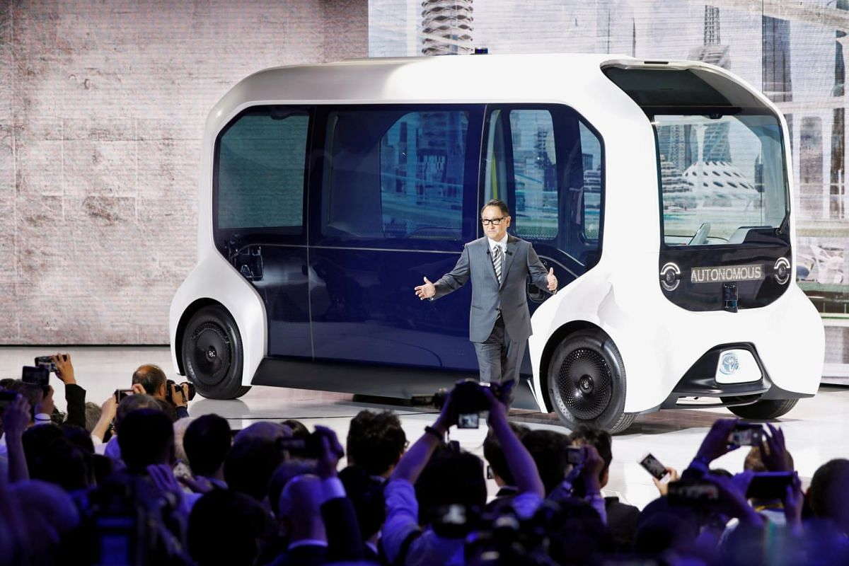 Toyota Motor Corporation President Akio Toyoda, shows the e-Palette autonomous concept vehicle at the Tokyo Motor Show, in Tokyo on Oct 23, 2019.