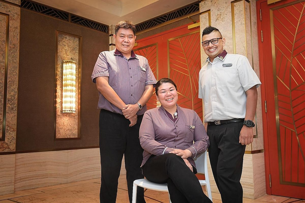 From left: SBS Transit bus drivers Ang Eng Huat and Lee Yee Ching, and assistant station manager Abdul Azim Abdul Azizam were honoured last week for their acts of kindness. ST PHOTO: ALPHONSUS CHERN