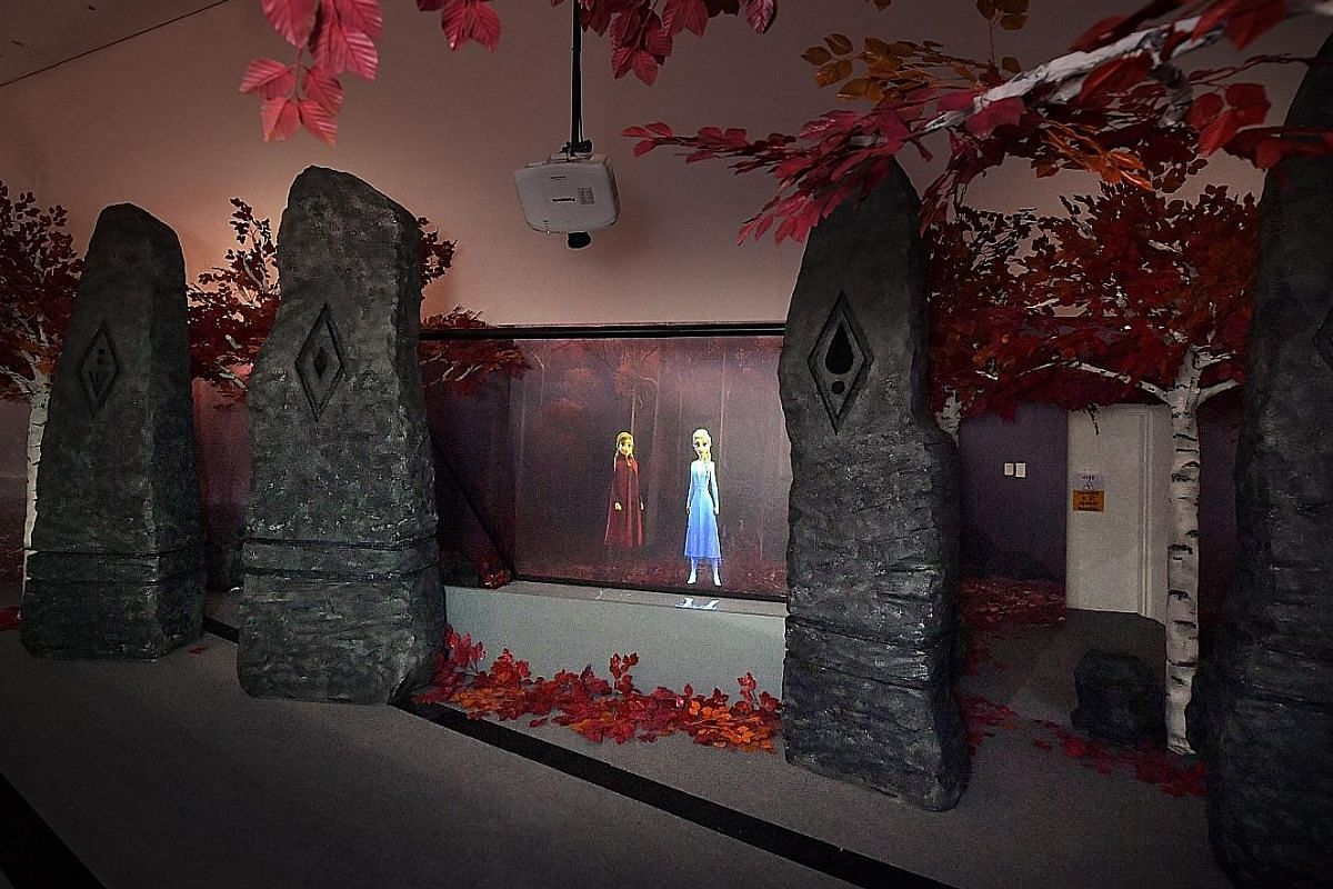 The Frozen II display at the Disney: Magic Of Animation exhibition includes artwork (above) of the film, which will be released on Nov 22. A set re-creation (above left) of Frozen II, where visitors can take wefies with the film's heroines; and Salud