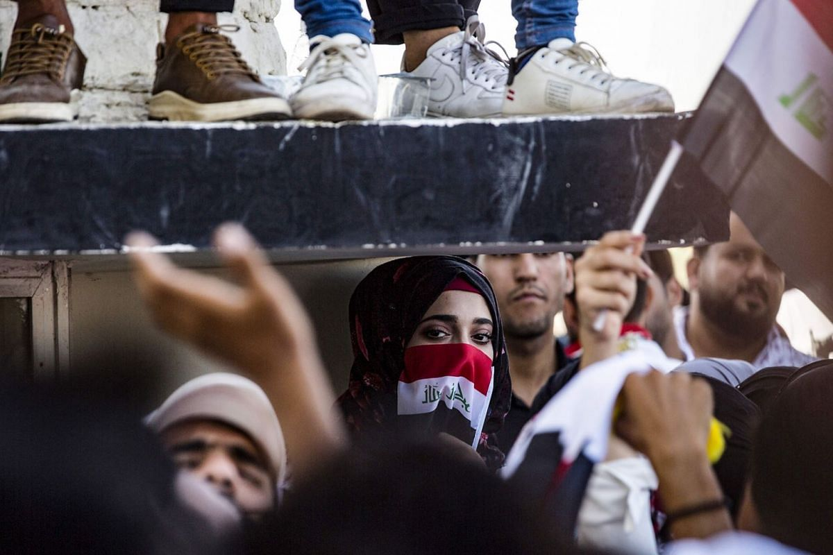 Iraqi students take part in an anti-government demonstration in front of their university in the centre of the southern city of Basra on Oct 29, 2019. Parts of Iraq have been engulfed by two waves of demonstrations this month over unemployment and co