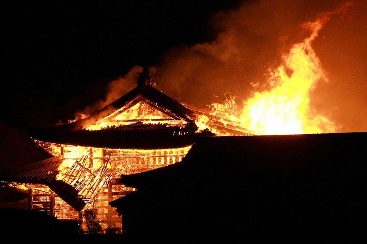 The main building of the Shuri Castle is seen on fire in Naha, Okinawa prefecture, southern Japan, early Oct 31, 2019. A fire started at  the castle, listed as a World Heritage site, destroying major buildings of the castle complex. The cause of the
