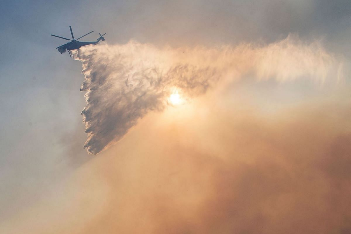 Firefighters battle to protect an area around the Reagan Library from the Easy Fire in Simi Valley, California on Oct 30, 2019.