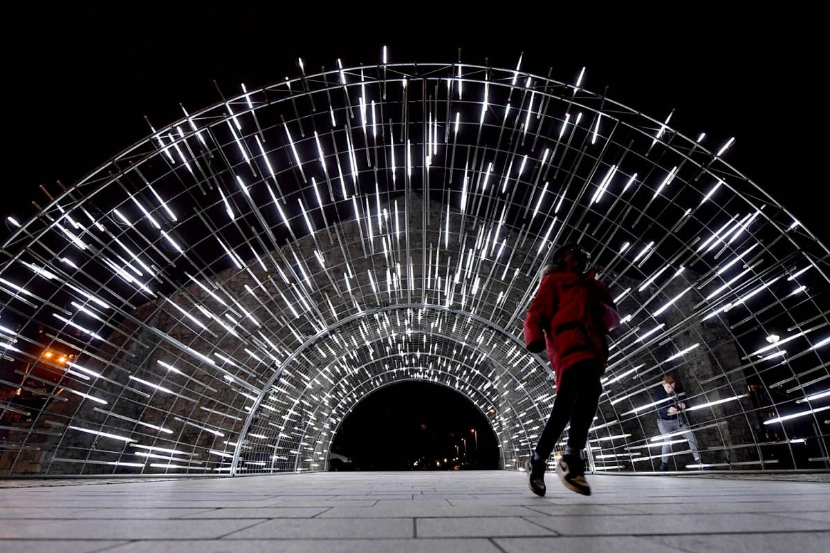 'Whole Hole', an artwork by Light Art Collection - Artist Vendel and de Wolf, is displayed during a press preview of the 'River of Light 2019', a nine-night festival of light, colour and spectacle created by international artists at Wapping Wall in L