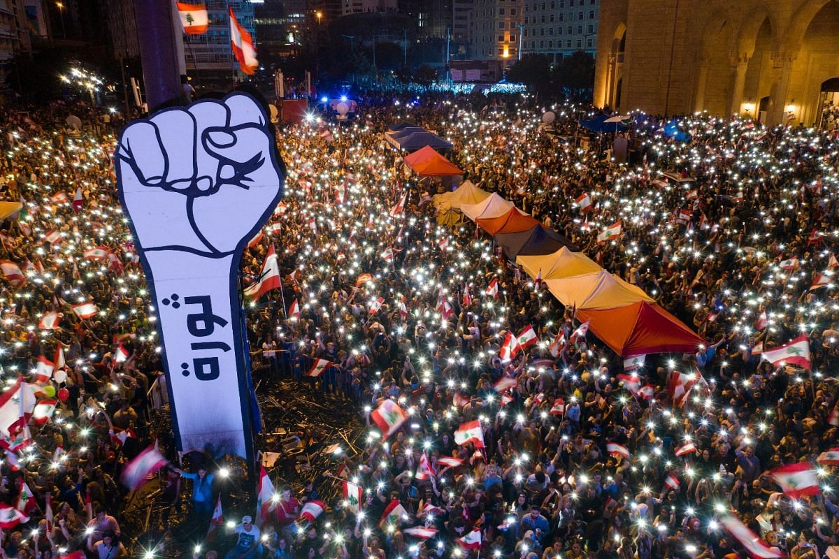 A picture taken with a drone shows an aerial view of protesters lighting up their phones as they gather at Martyrs' Square during ongoing anti-government protests in Beirut, Lebanon on Nov 3, 2019. Protesters demand the president make parliamentary c