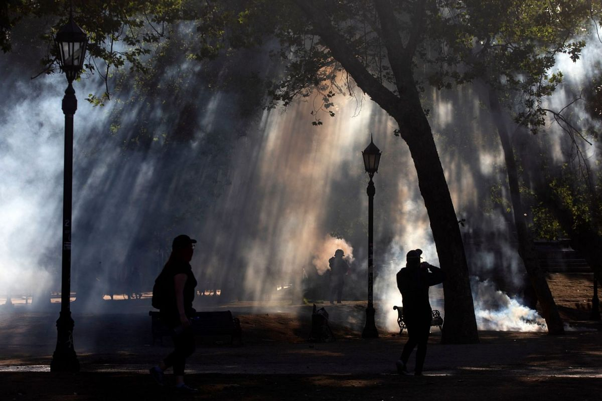 Demonstrators clash with security forces during a protest against the government of Chilean President Sebastian Pinera in Santiago on Nov 3, 2019. Unrest in Chile began on Oct 18 with protests against a rise in metro ticket prices and other austerity