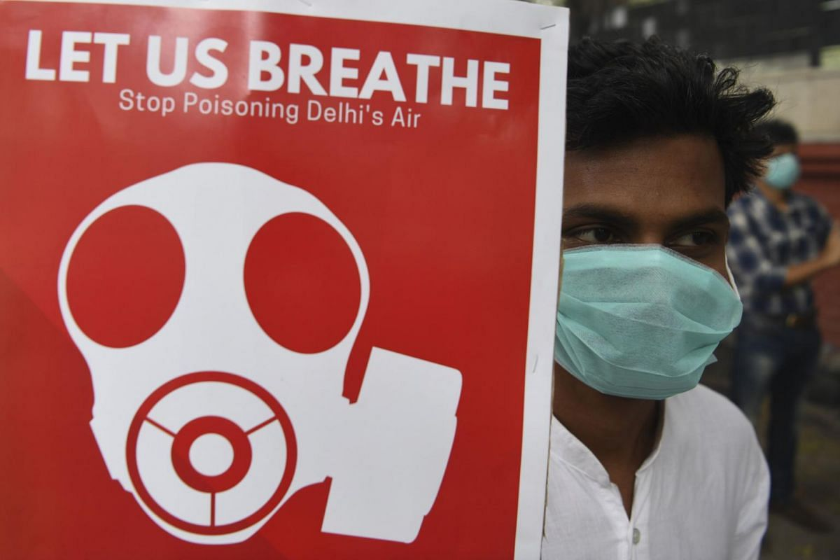 A demonstrator wearing a face mask due to heavy smog conditions takes part in a demonstration demanding the government to implement measures to curb air pollution in New Delhi, on Nov 3, 2019.