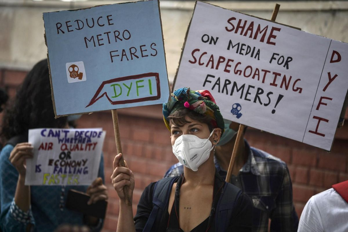 Demonstrators wearing face masks due to heavy smog conditions take part in a demonstration demanding the government to implement measures to curb air pollution in New Delhi, on Nov 3, 2019.