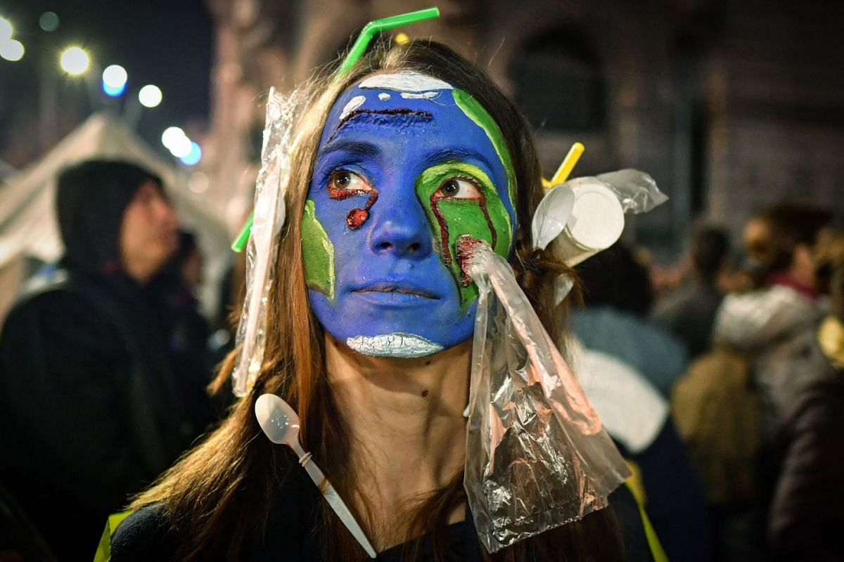 A woman wearing plastic on her hair and with her face painted with earth colors demonstrates during a protest against illegal logging in the forests of Romania gathering aroung 4,000 people downtown Bucharest, Romania, on Nov 3, 2019. - Around 200 Ro