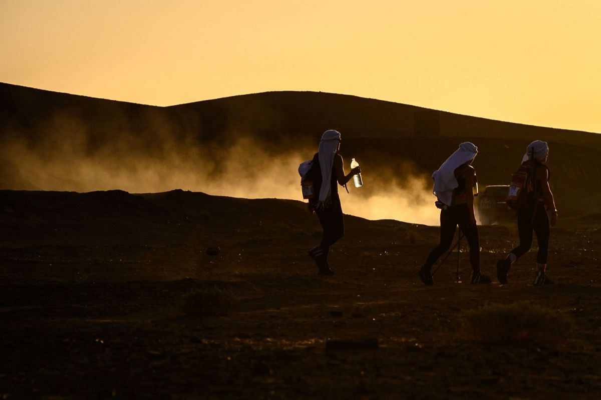 """Women take part in the desert trek """"Rose Trip Maroc"""" in the erg Chebbi near Merzouga on Nov 3, 2019. The Rose Trip Maroc is a female-oriented trek where teams of three must travel through the southern Moroccan Sahara desert with a compass, a map and"""