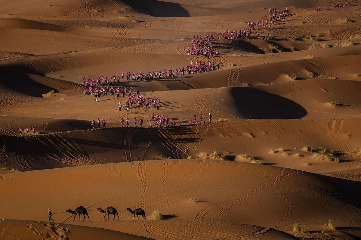 """Women take part in the desert trek """"Rose Trip Maroc"""" on Nov 4, 2019 in the Erg Chebbi near Merzouga, Morocco. The Rose Trip Maroc is a female-oriented trek where teams of three must travel through the southern Moroccan Sahara desert with a compass, a"""