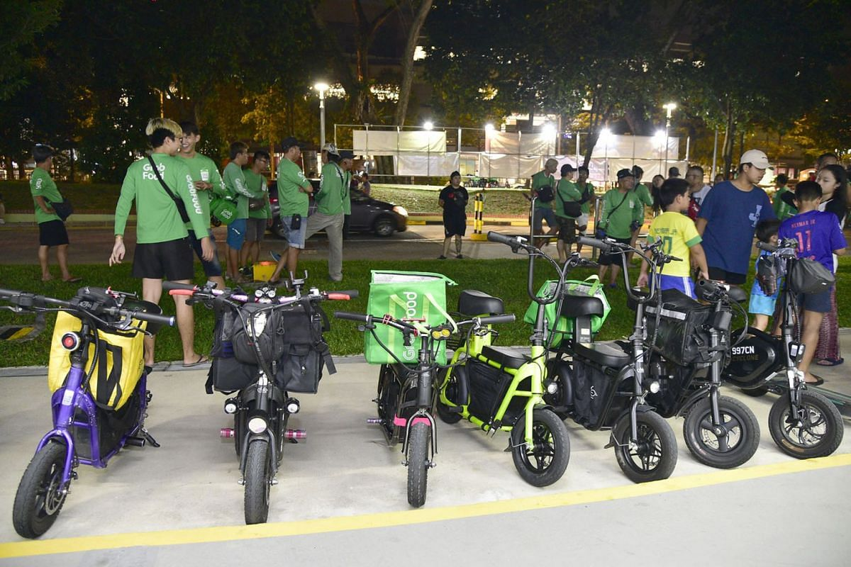 More than 50 Grab Food delivery riders who rely on e-scooters have called for each other to attend a Meet The People session at PM Lee Hsien Loong's Teck Ghee ward on Nov 6, 2019, to raise concerns about the ban on PMDS from footpaths. PHOTO: THE STR
