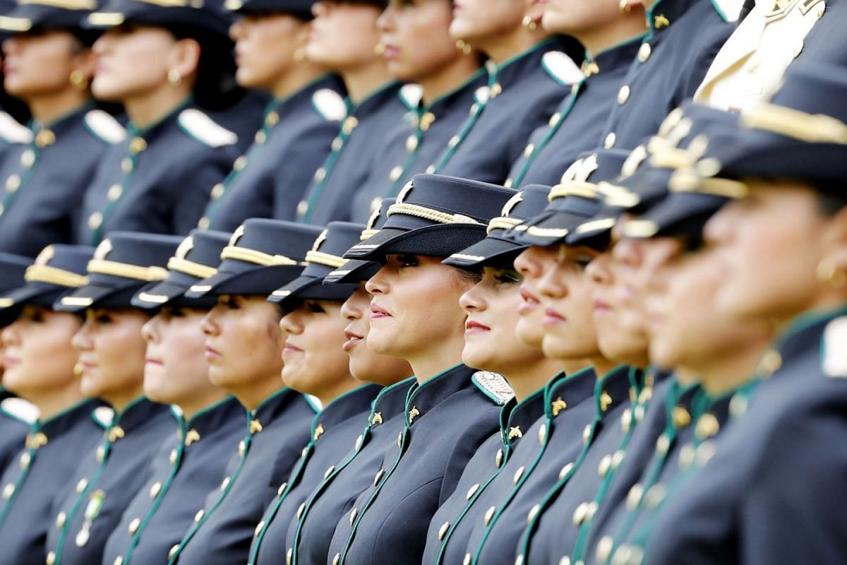 Police deputy superintendents participate in a police graduation and promotion ceremony, in Bogota, Colombia, Nov 7, 2019. Colombian President Ivan Duque criticized the recruitment of minors by illegal armed groups that use them as 'human shields', i