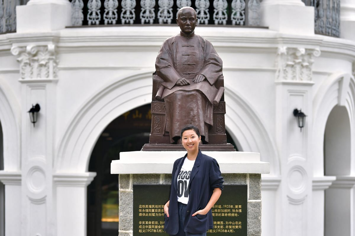 Designer Beatrix Ong (above, with a statue of her great-granduncle Sun Yat Sen) designed merchandise for the Sun Yat Sen Nanyang Memorial Hall, including badges and tote bags.