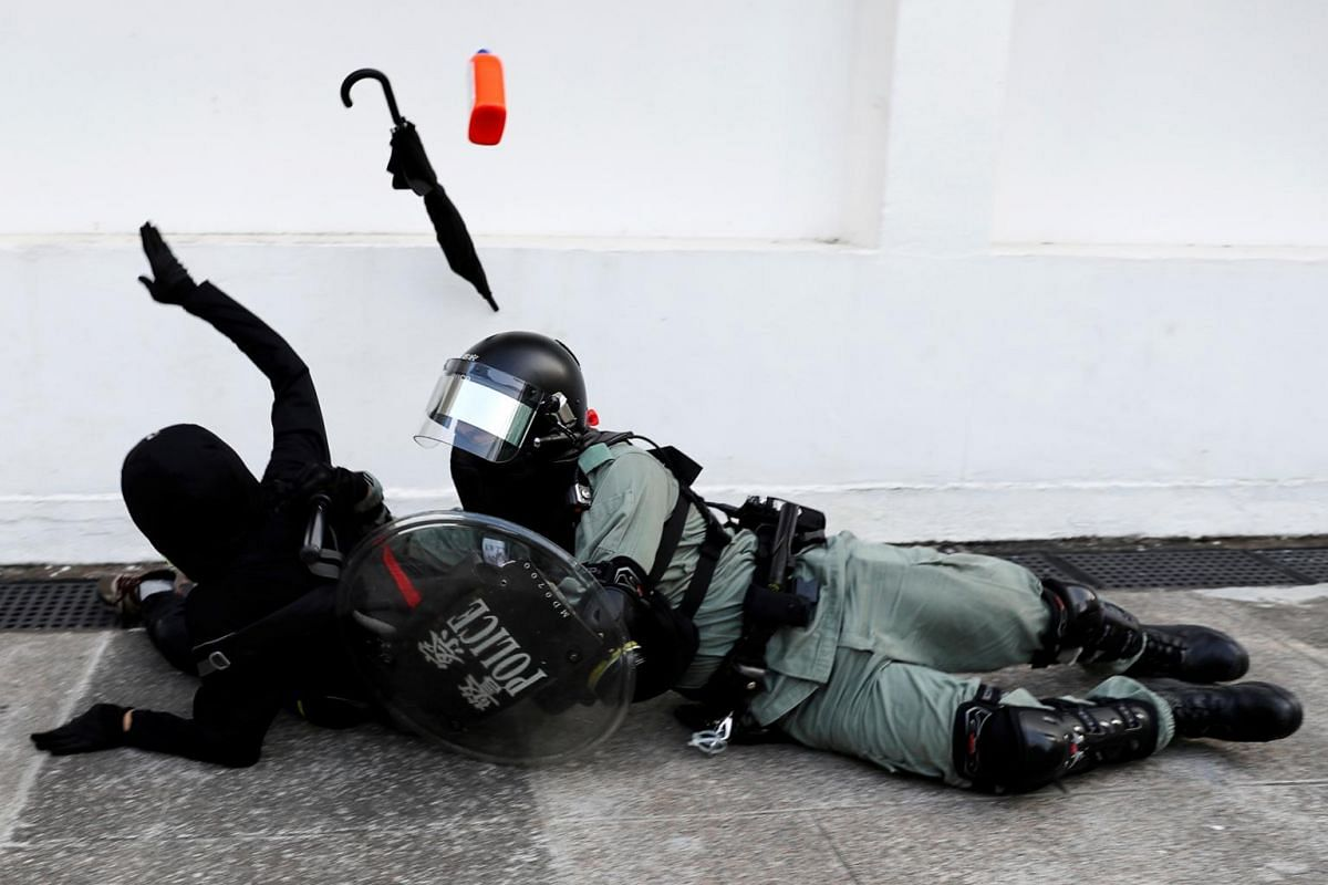 A riot police officer tries to subdue a protester during an anti-government demonstration in Hong Kong, on Nov 10, 2019.