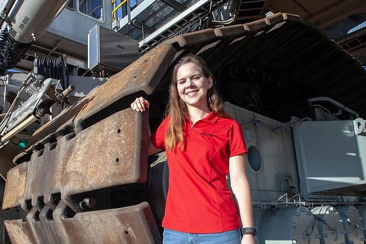 Mechanical engineer Breanne Stichler with Nasa's Crawler-Transporter 2 at the Kennedy Space Centre in Florida in August. She is the youngest and the first female in a while to drive the 3-million-kg machine.