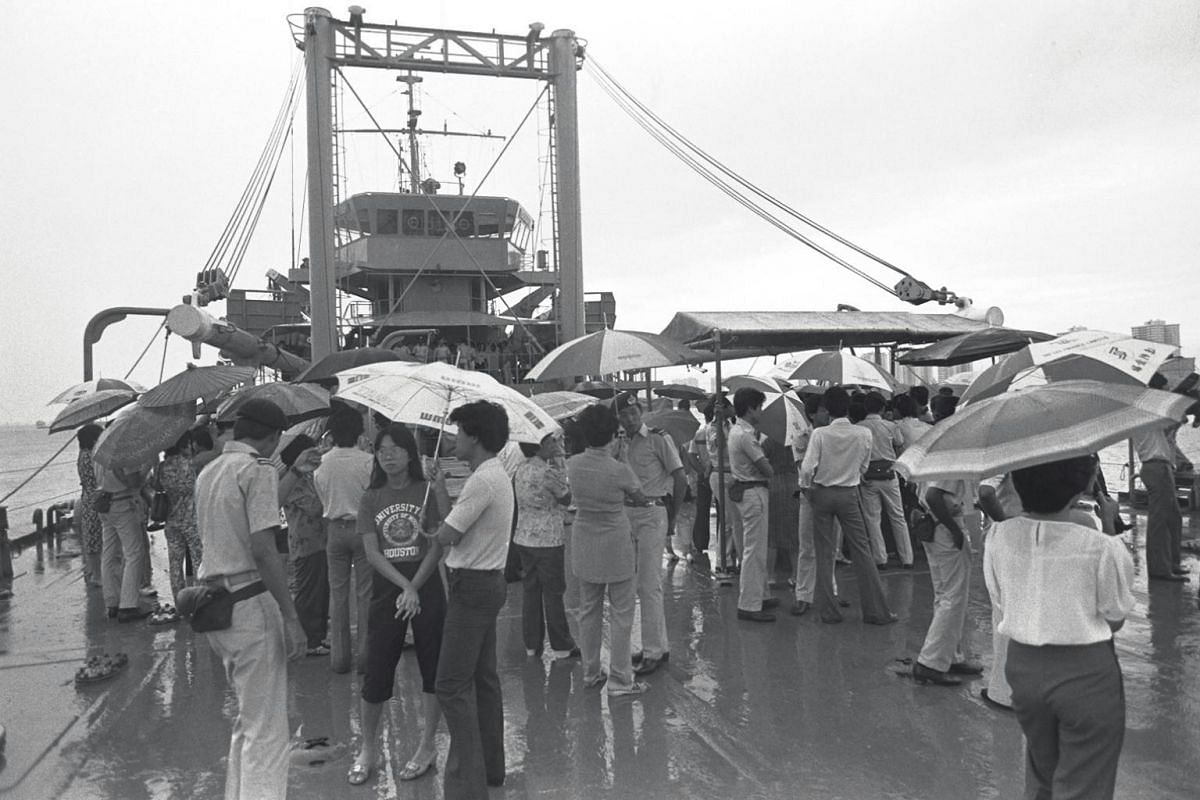The RSS Resolution docks at Bedok Jetty as family members and loved ones of the crew members wait to greet them. The jetty was built by local businessman Yap Swee Hong in 1966 for private use. It was later used by Mindef as a military base for conduc