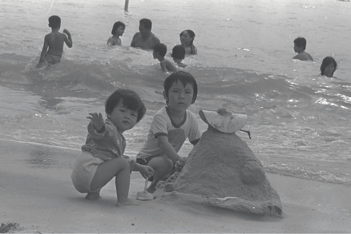 Children play in the sand at East Coast Park in 1980. The park, which opened in 1972, is Singapore's largest and has 7.5 million visits annually.
