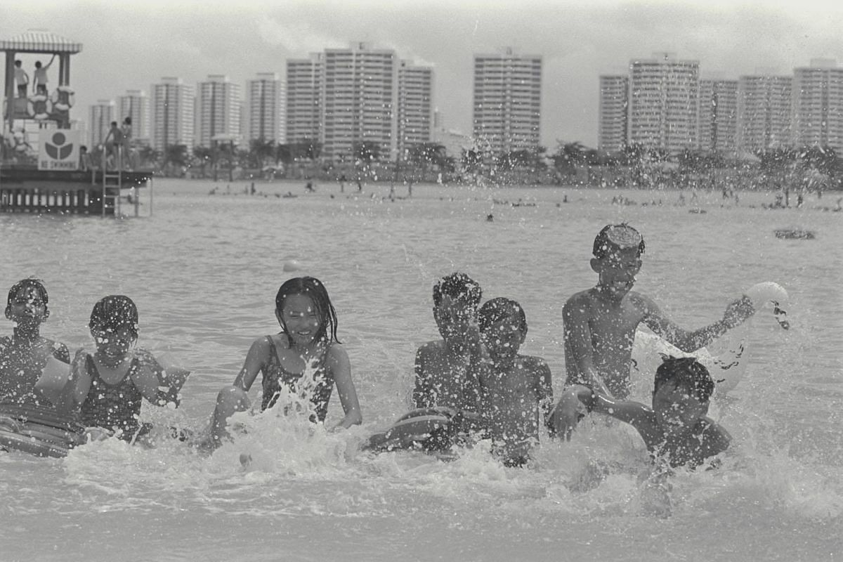 Children play in the East Coast Park Lagoon on its opening day in 1976. It was the size of 40 Olympic-sized pools and could accommodate up to 6,000 people.