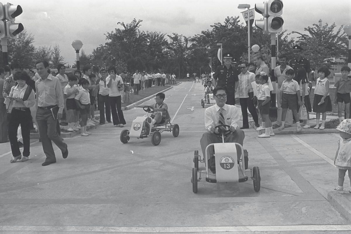 Minister for Home Affairs Chua Sian Chin takes a short drive during the opening of the road safety park at East Coast Park in 1981. The road safety park was built to inculcate a sense of courtesy among road users.