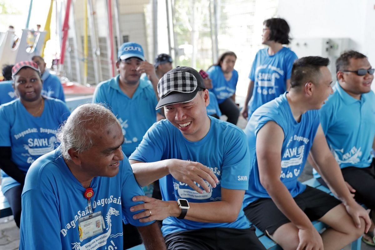 Mr Loo (front row, second from left) giving his teammate Chandra Mohan Naray a massage after training at PAssion WaVe @ Marina Bay a week before the race. The former systems engineer is now a freelance massage therapist. Ten years ago, he was diagnosed wi