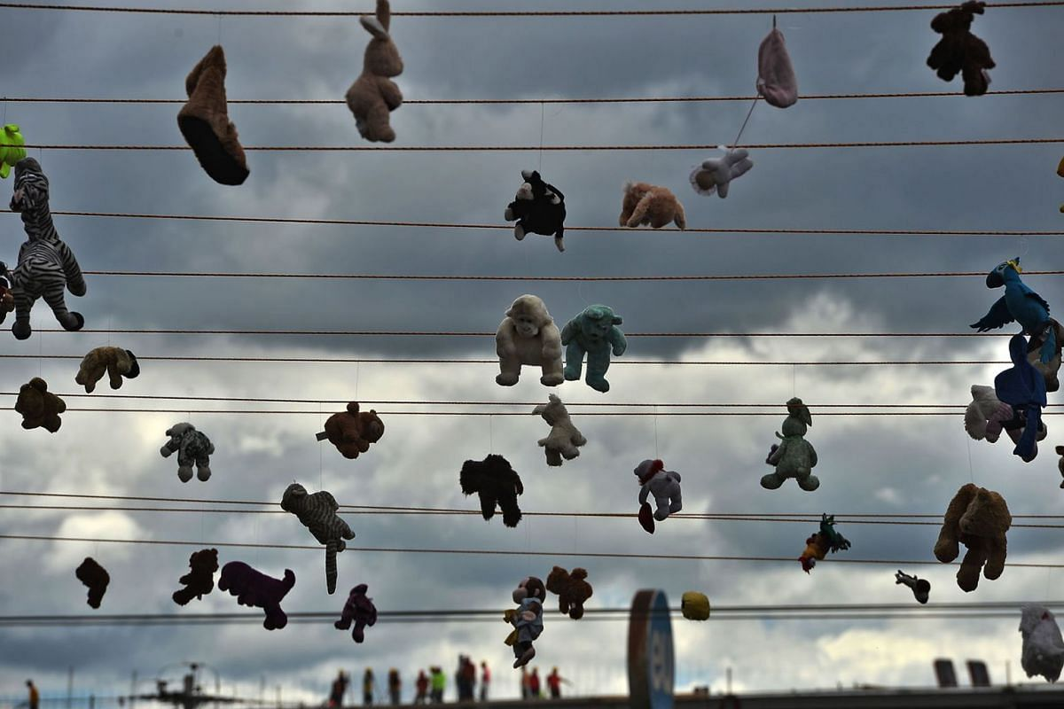 View of stuffed animal toys hanged from ropes in remembrance of murdered women, in the framework of the International Day for the Elimination of Violence against Women, in Tegucigalpa, on November 25, 2019. According to human rights organizations, 5,