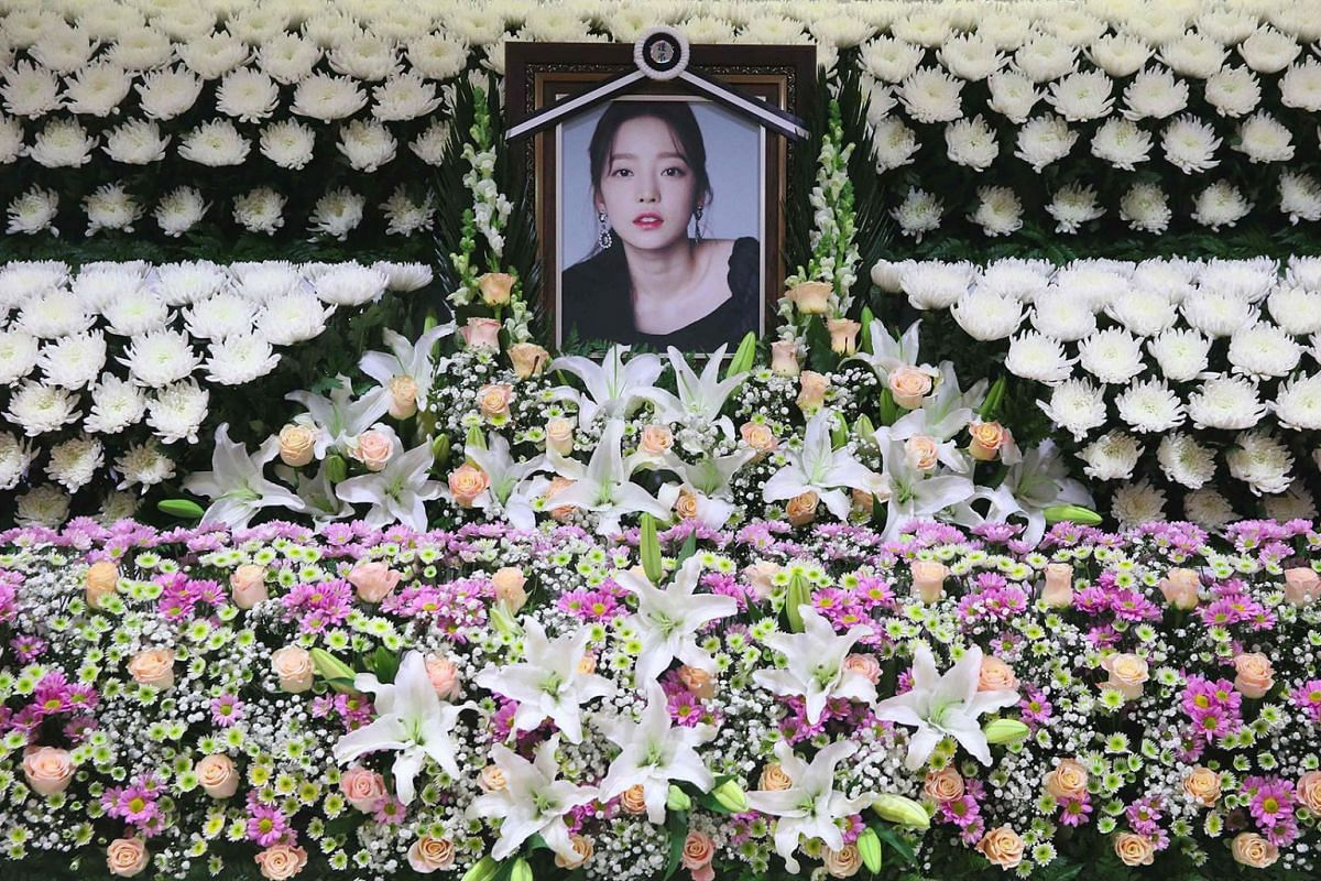 The portrait of late K-pop star Goo Hara is seen surrounded by flowers at a memorial altar at a hospital in Seoul on November 25, 2019. Fans mourned and questions were asked after K-pop star and revenge porn victim Goo Hara was found dead in a possib