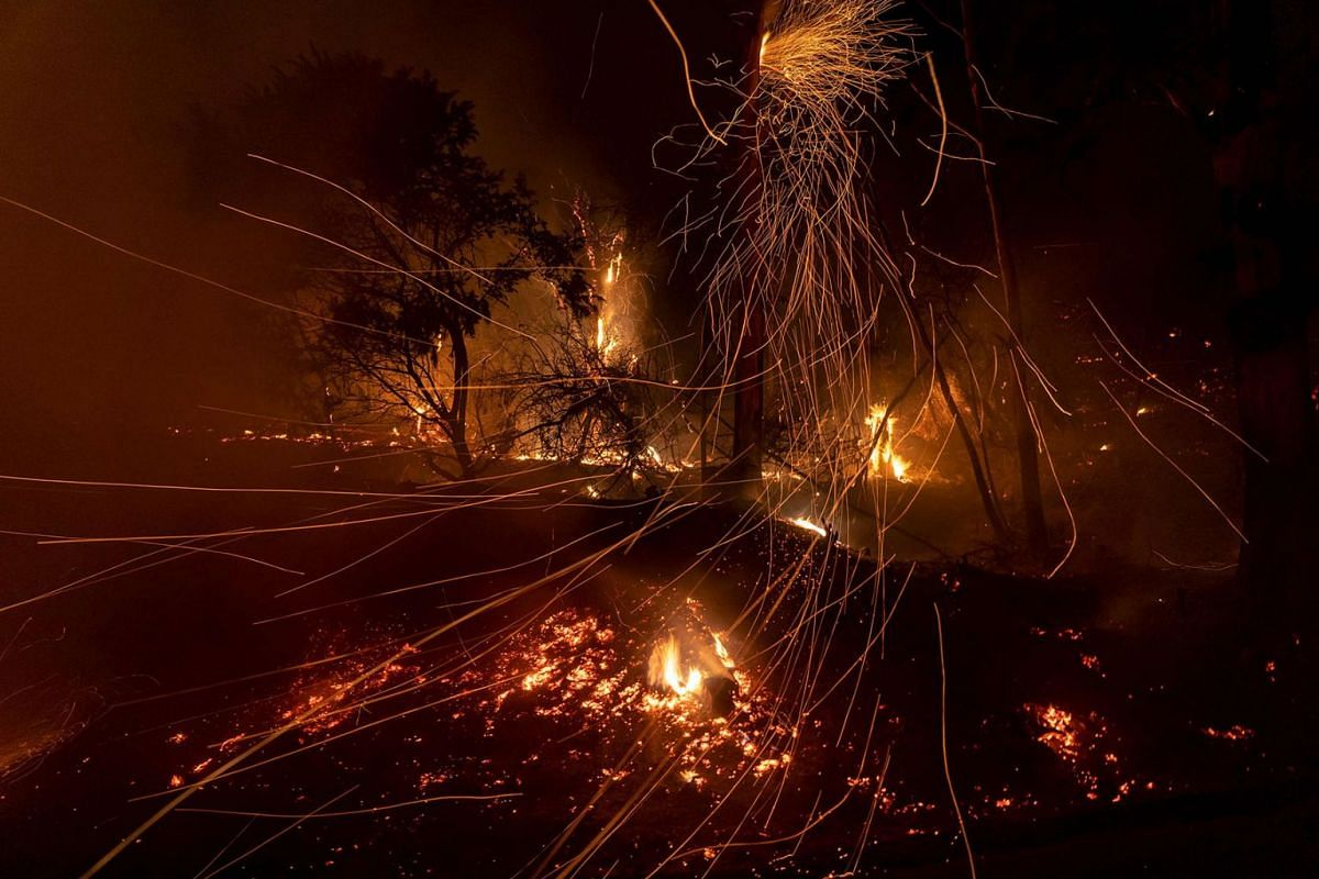 Wind blows embers as the Cave fire burns a hillside in Santa Barbara, California on November 26, 2019. PHOTO: AFP