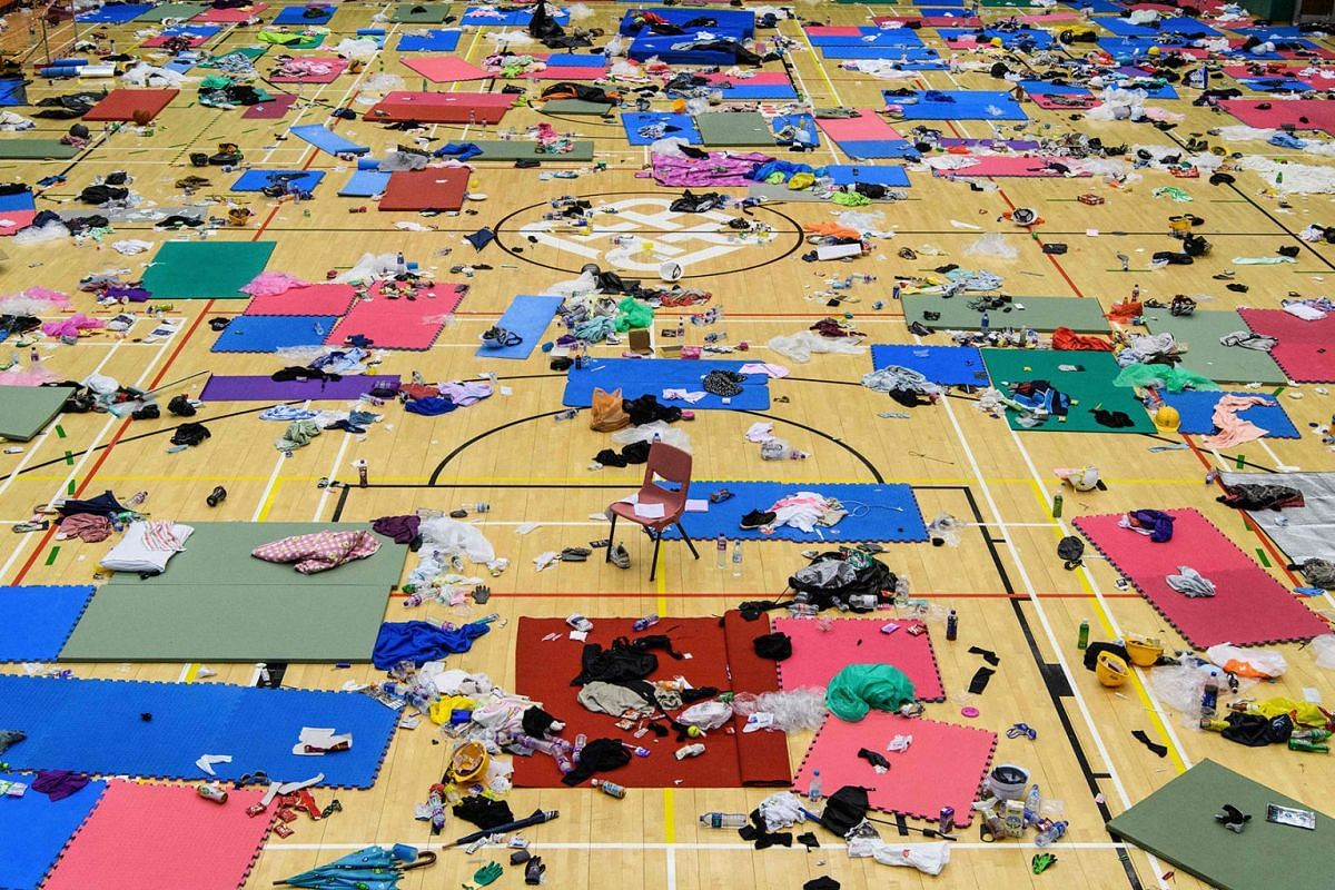 Scattered clothes, protective gear and other objects are seen in a basketball hall in the Hong Kong Polytechnic University in the Hung Hom district of Hong Kong on November 26, 2019, over a week after police surrounded the building while protesters w