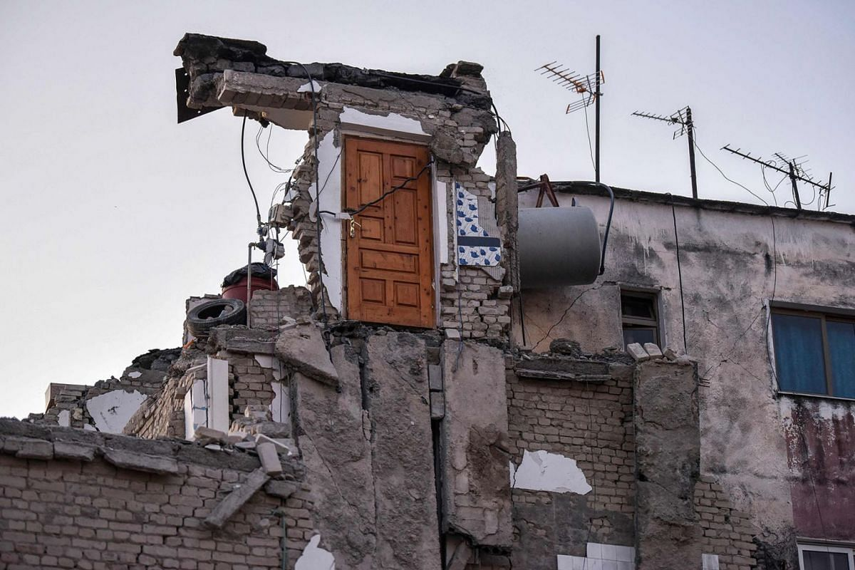 A picture taken on November 26, 2019 shows a collapsed building in Thumane, northwest of capital Tirana, after an earthquake hit Albania. PHOTO: AFP