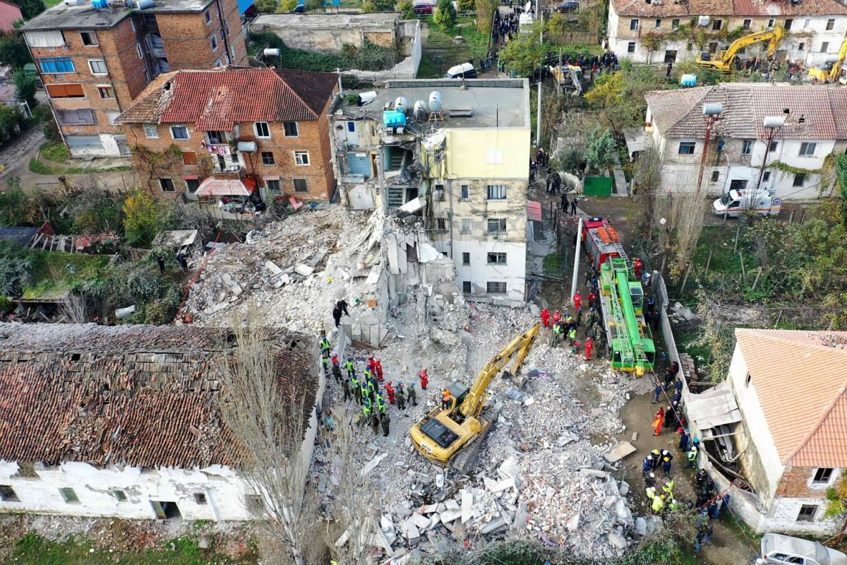 Emergency workers seen during an operation at a collapsed building in Thumane, northwest of capital Tirana, after an earthquake hit Albania.