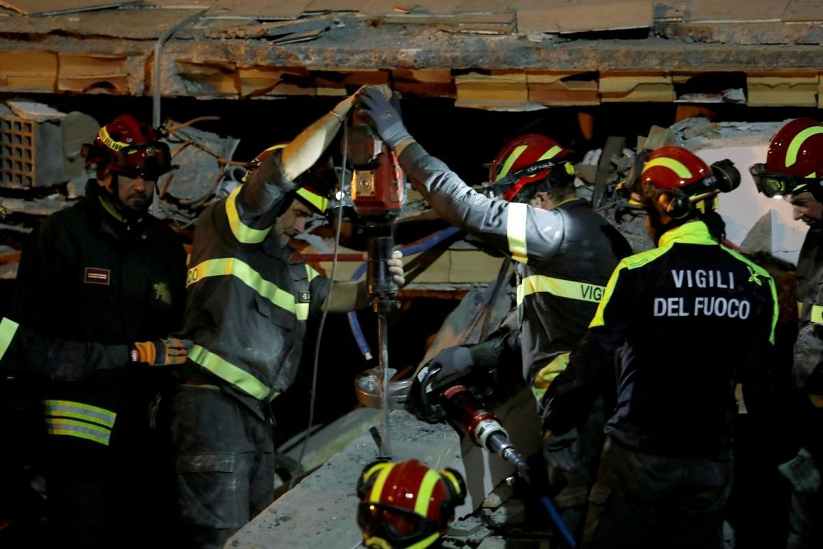 Italian firefighters work at the site of a collapsed building in the town of Durres, following the powerful earthquake that shook Albania, on Nov 27, 2019.