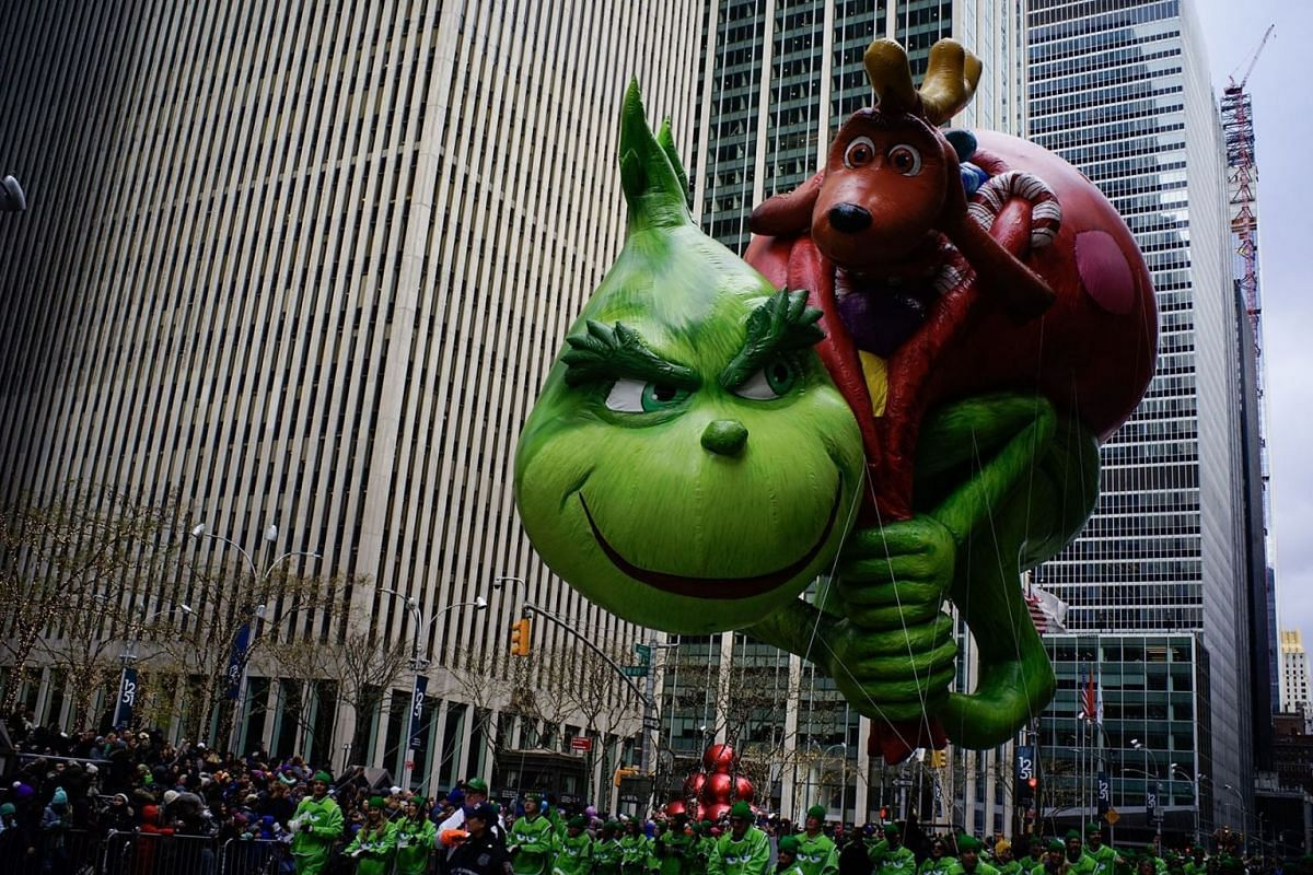 The Grinch balloon floats down Sixth Avenue during the Macy's Thanksgiving Day Parade, Thursday, Nov. 28, 2019, in New York. PHOTO: AP