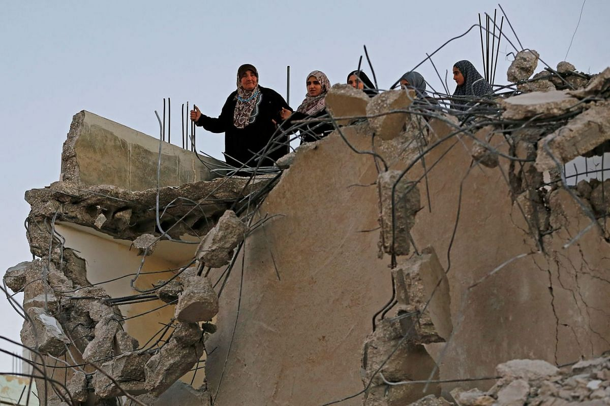 Women stand atop destroyed family house of Palestinian assailant Asafra after it was demolished by Israeli forces, in Biet Kahel in the Israeli-occupied West Bank November 28, 2019. PHOTO: REUTERS