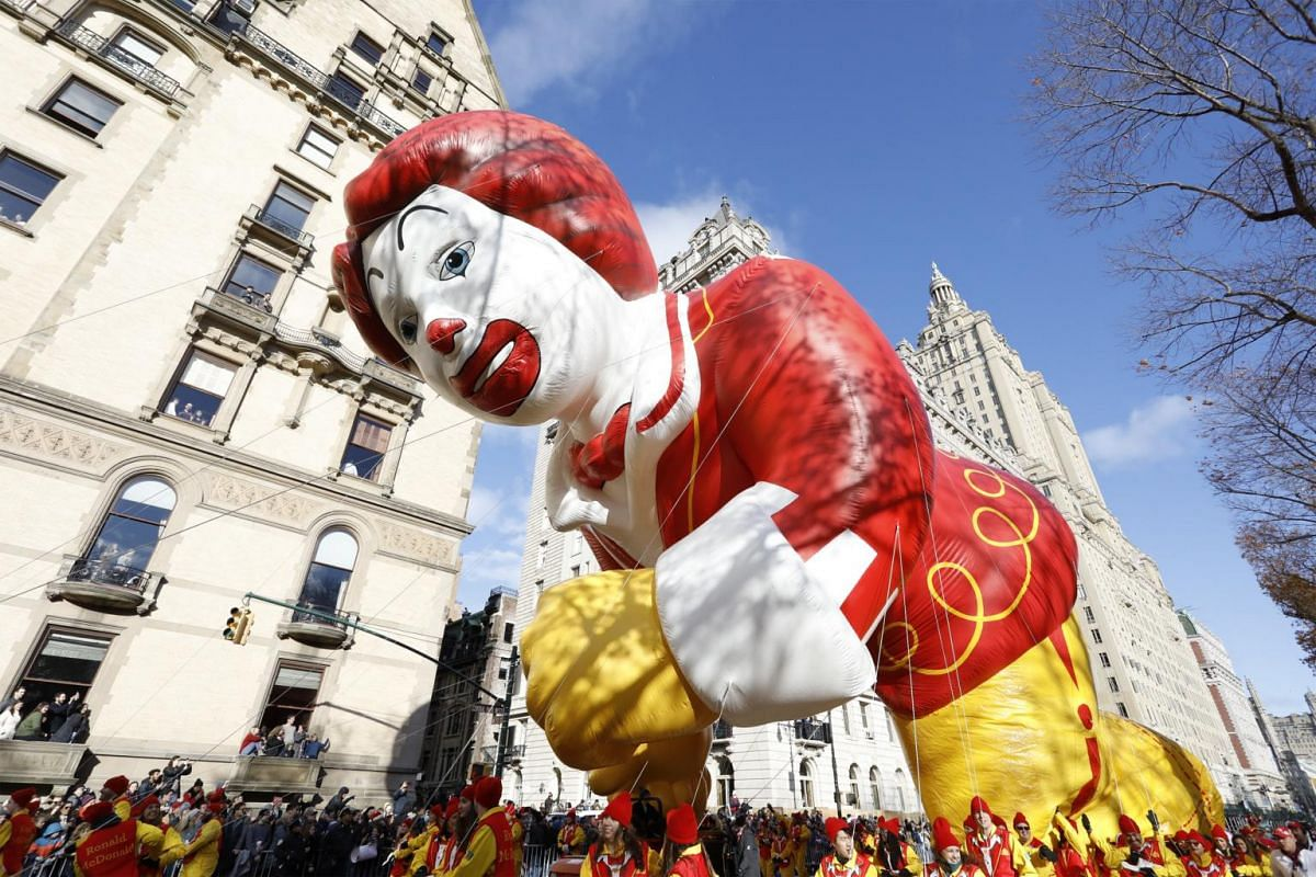 The Ronald McDonald balloon floats down Central Park West during the 93rd Annual Macy's Thanksgiving Day Parade in New York, on Nov 28, 2019.