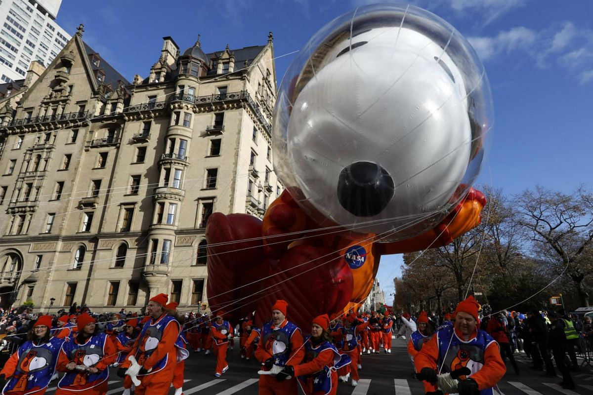 The Astronaut Snoopy balloon floats down Central Park West during the 93rd Annual Macy's Thanksgiving Day Parade in New York, on Nov 28, 2019.