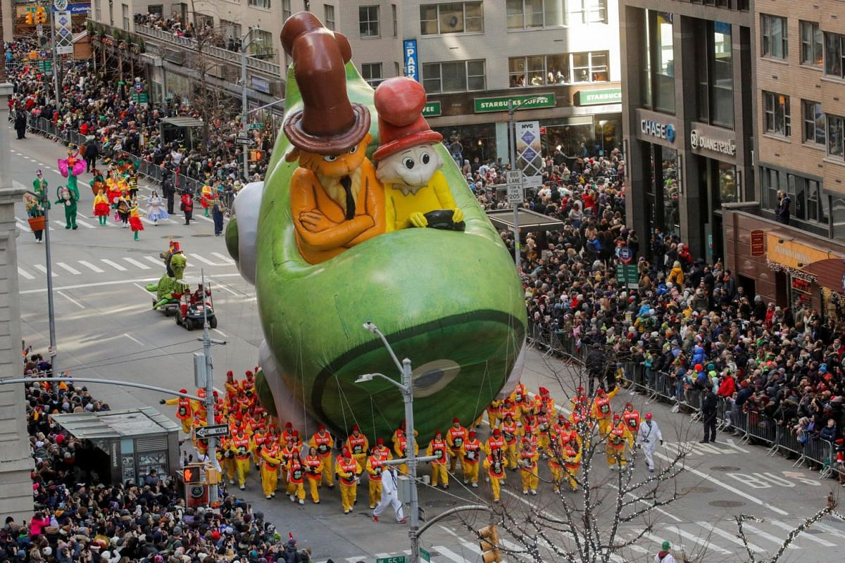 Dr. Seuss' Green Eggs and Ham balloon hovers above the crowd during the 93rd Macy's Thanksgiving Day Parade in Manhattan, New York, on Nov 28, 2019.